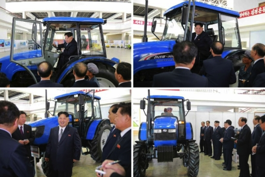 Kim Jong Un looks at and inspects a tractor developed by Ku'mso'ng Tractor Plant for the 7th Party Congress (Photo: Rodong Sinmun).