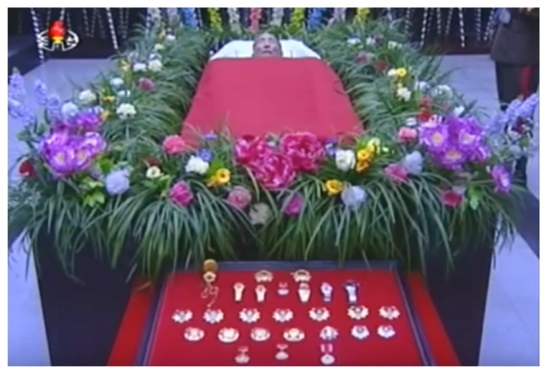 View of the casket and a display of the state awards, titles and commemorative watches Kang Sok Ju was given during his career (Photo: Korean Central TV).
