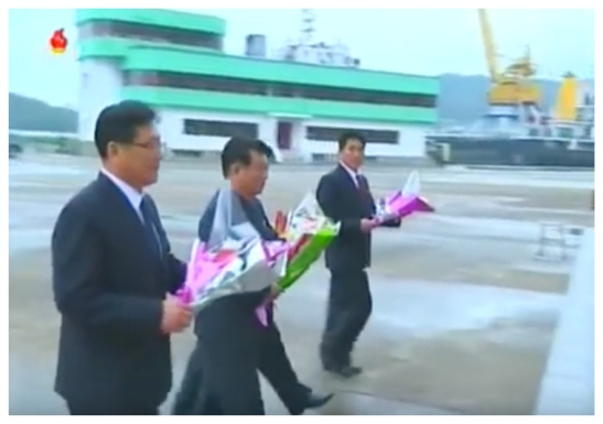 WPK Vice Chairman and Executive Policy Council Member O Su Yong along other senior DPRK officials delivers a floral bouquet to icons of Kim Il-so'ng and Kim Cho'ng-il at the Ryongnam Dockyards (Photo: Korean Central TV).