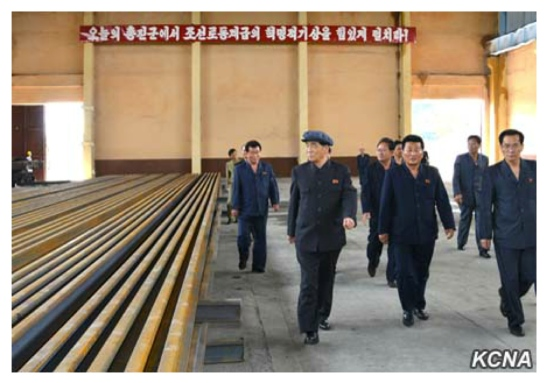 DPRK Premier Pak Pong Ju and WPK Vice Chairman O Su Yong tour industrial upgrades at Hwanghae Iron and Steel Complex in Songrim, North Hwanghae Province, on May 24, 2016 (Photo: KCNA).