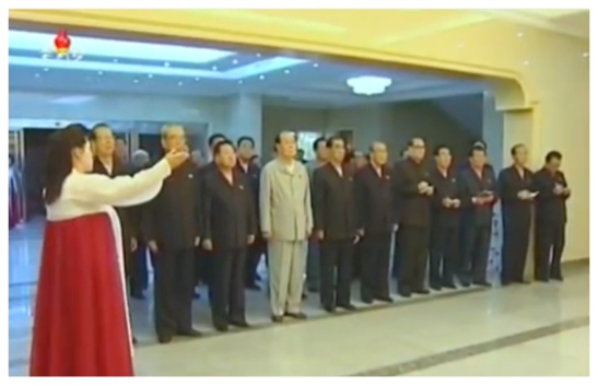 A docent guides a tour of the Kim Il Sung University Revolutionary History Museum by DPRK central leadership on June 19, 2016 (Photo: Korean Central TV).