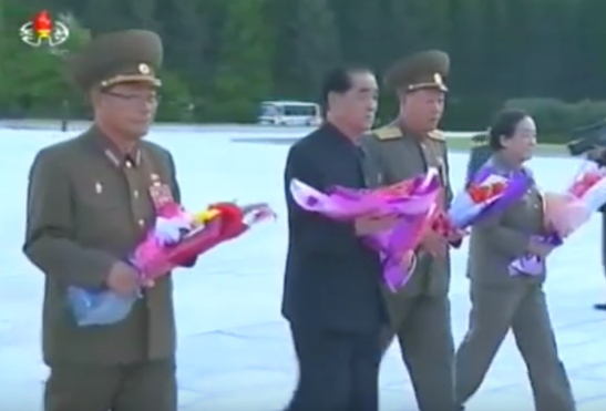 Minister of the People's Armed Forces and WPK Political Bureau Member General Pak Yong Sik, DPRK Prime Minister and WPK Political Bureau Presidium Member Pak Pong Ju, Minister of the People's Security and WPK Political Bureau Member General Choe Pu Il and WPK Party History Institute Director Kim Jong Im delivers floral bouquets to the Kim Il Sung statue at the Samjiyo'n Grand Monument on June 4, 2016 (Photo: Korean Central TV).