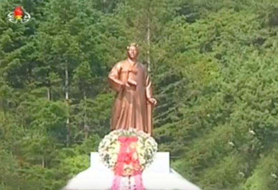 Kim Jong Un floral wreath in front of the Kim Hyong Jik statue in Chunggang County, Chagang Province. (Photo: Korean Central TV).