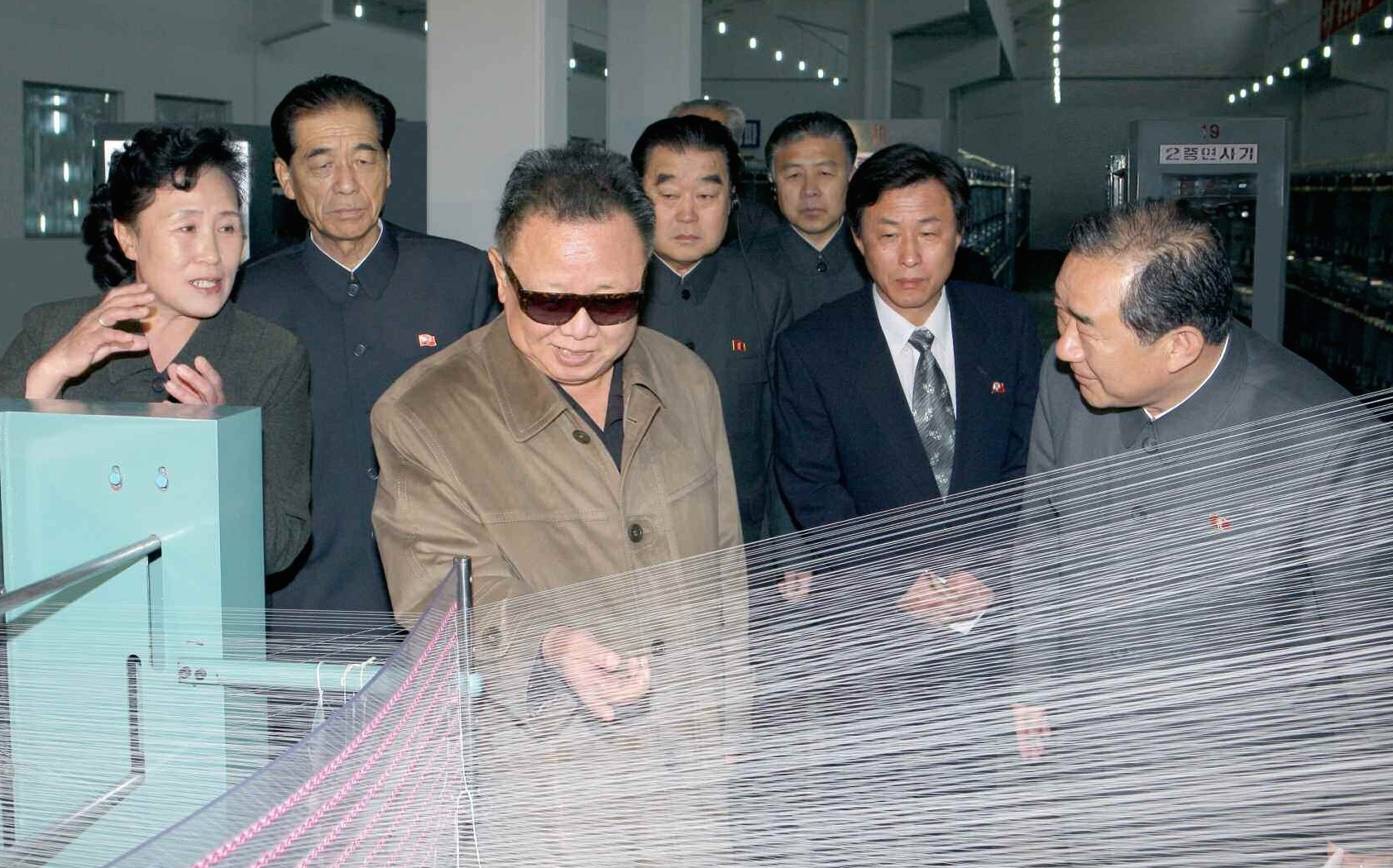 An Jong Su with late DPRK leader at a textile factory in 2010