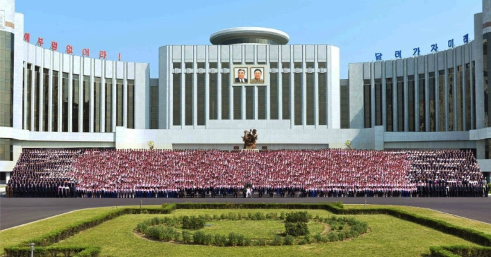 Commemorative photograph taken on June 7, 2016 in front of the Mangyo'ngdae Scholchildren's Palace in Pyongyang of Kim Jong Un with delegated to events marking the 70th anniversary of the Korean Children's Union (Photo: Rodong Sinmun).