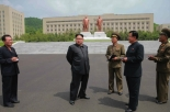Kim Jong Un on the campus of the National Defense University.  Also in attendance are WPK Vice Chairman for Munitions Industry Ri Man Gon (2nd right) and WPK Munitions Industry Department Deputy Director Yu Jin (left) (Photo: Rodong Sinmun).
