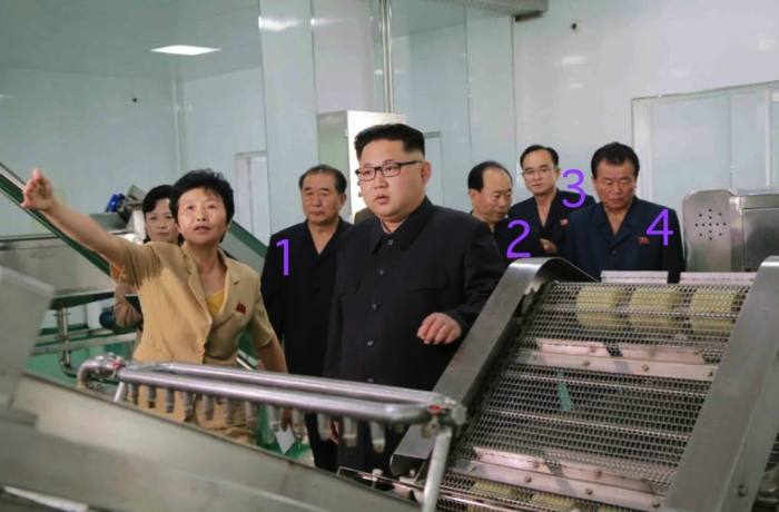 Attending the inspection of the pickle factory were: WPK Light Industry Department Director An Jong Su [1], WPKLight Industry Department Deputy Director Sin Man Gyun [2], WPK Organization Guidance Department Deputy Director Jo Yong Won and WPK Vice Chairman and WPK Political Bureau Member O Su Yong (4)