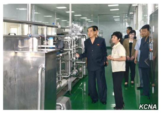 DPRK Premier and WPK Political Bureau Presidium Member Pak Pong Ju [a] and State Planning Commission and WPK Political Bureau Member Ro Tu Chol [b] tours the February 8 Vinalon Complex in Hamhu'ng, South Hamgyo'ng Province (Photo: KCNA).