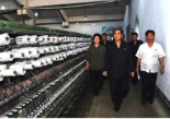 DPRK Premier Pak Pong Ju tours the knitting shop in the Sinu'iju Chemical Fiber Mill as published on the bottom left of page two of the WPK's daily newspaper Rodong Sinmun (Photo: Rodong Sinmun).