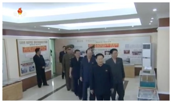 WPK Vice Chairman and WPK Political Bureau Presidium (standing committee) member Choe Ryong Hae, State Planning Commission Chairman and WPK Political Bureau Member Ro Tu Chol and other senior officials visit the factory's history exhibition (Photo: Korean Central TV).