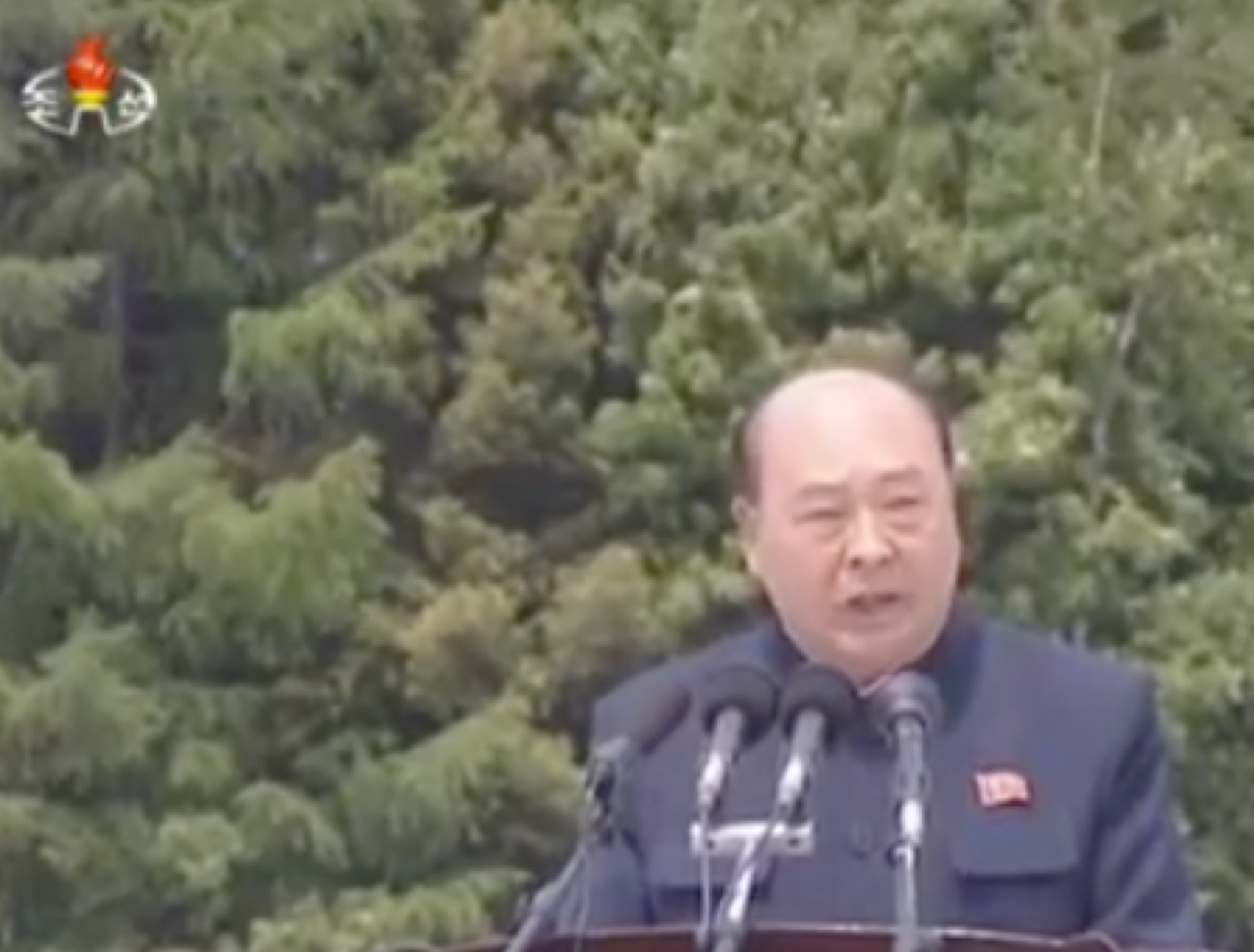 Chairman of the Yanggang WPK Provincial Committee RI Sang Won presides over a meeting marking the 60th anniversary of study tours at revolutionary battle sites in Samjiyo'n (Photo: Korean Central TV).