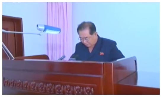 WPK Light Industry Department Director An Jong Su reads a message at a July 14, 2016 meeting marking the 40th anniversary of the U'nha Guidance Bureau (Photo: Korean Central Television).