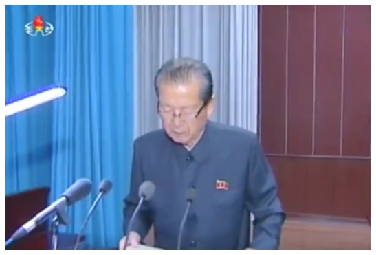 WPK Vice Chairman Choe T'ae Bok reads out a message at a July 14, 2016 meeting marking the 30th anniversary of the foundation of the Pyongyang IT Bureau (Photo: Korean Central Television).