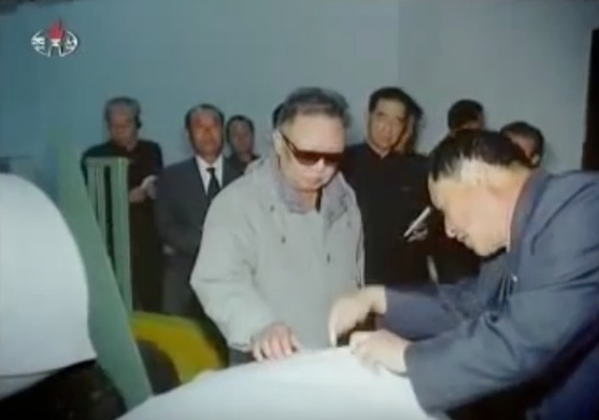 Late DPRK leader Kim Jong Il is briefed about production at P'yo'ngso'ng Synthetic Leather Factory during an October 7, 2011 visit (Photo: NK Leadership Watch file photo).