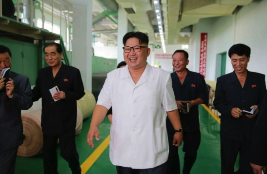 Kim Jong Un tours the P'yo'ngso'ng Synthetic Leather Factory in a photo that appears on the cover of the July 12, 2016 edition of the WPK daily newspaper Rodong Sinmun. Also in attendance, second from left, is DPRK Premier Pak Pong Ju (Photo: Rodong Sinmun).