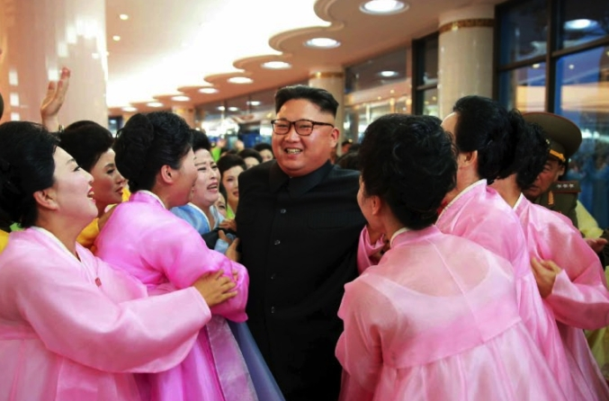 Kim Jong Un greets the wives of KPA officers following their concert held as part of an art performance contest in a photo on the front page of the July 16, 2016 edition of WPK daily newspaper Rodong Sinmun (Photo: Rodong Sinmun).