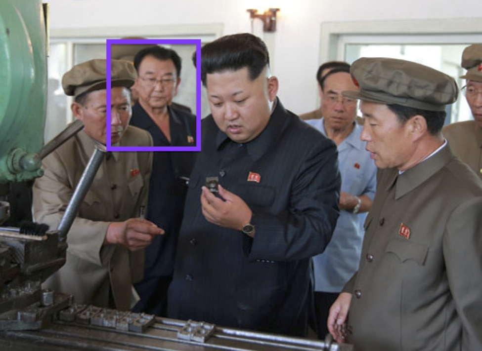 Ri Man Gon at a tour of a Sinu'iju Measuring Instrument Factory in 2015