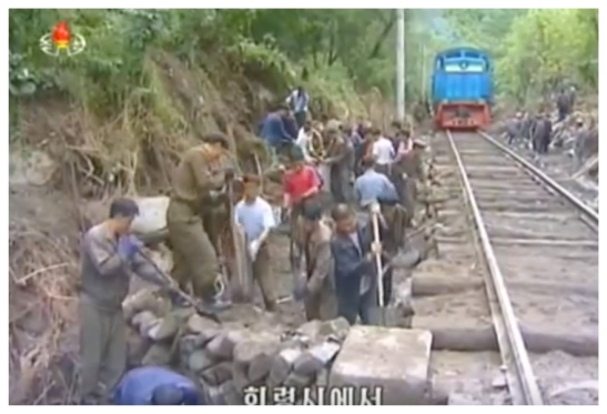 A railway trackbed is repaired as part of flood relief work in North Hamgyo'ng Province (Photo: Korean Central Television).
