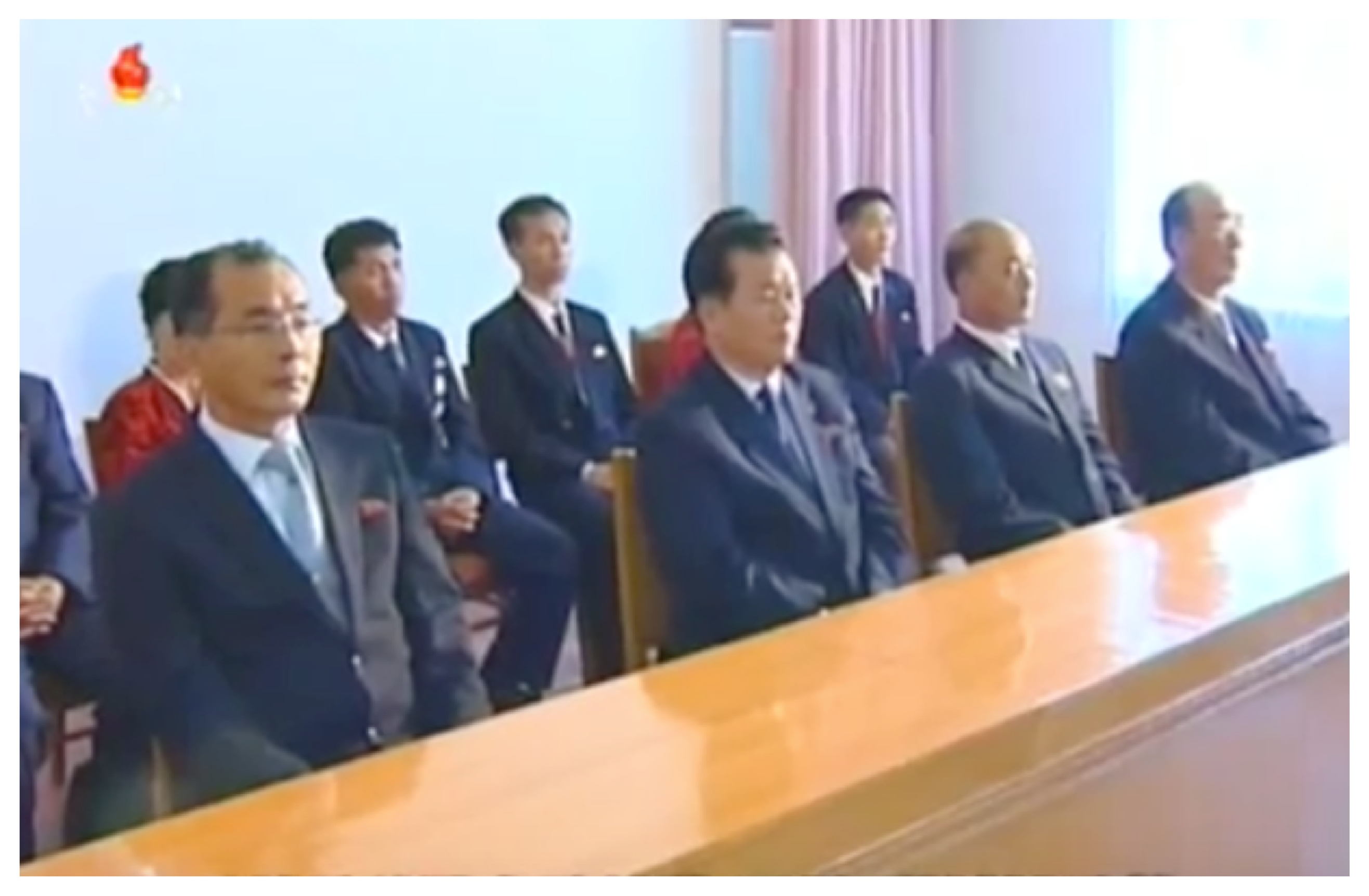 Kim Kwang Chol (left) attends an anniversary report meeting in October 2015 (Photo: Korean Central Television).