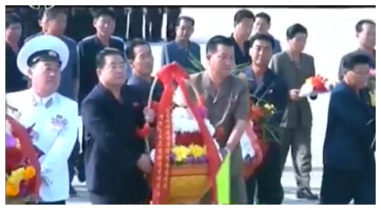 South Hamgyo'ng WPK Provincial Committee Chairman Kim Song Il [2nd left] delivers a floral basket to the KJS Statue at the Kim Jong Suk Naval Academy in South Hamgyo'ng Province on September 22, 2016 (Photo: Korean Central Television)