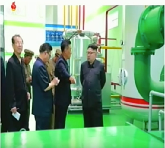 Kim Jong Un tours the Medical Oxygen Factory. Also in attendance (left) is WPK Vice Chairman for Science and Education, WPK Political Bureau Member and Supreme People's Assembly Speaker (chairman) Ch'oe T'ae-pok (Photo: Korean Central Television).