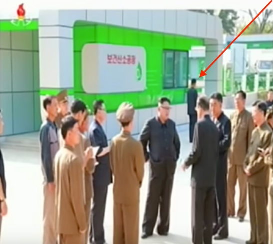 Kim Jong Un concluding his visit to the recently constructed Medical Oxygen Factory. Tagged in the photo is a member of Jong Un's close security escort (Photo: Korean Central Television)