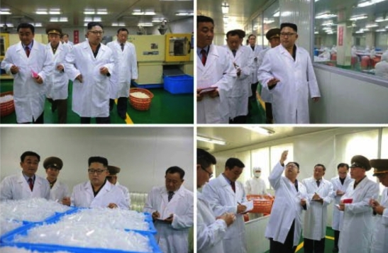 Kim Jong Un tours and inspects products of the Taedonggang Syringe Factory in photos which appeared on the bottom left of the front page of the September 24, 2016 edition of the WPK daily organ Rodong Sinmun (Photos: Rodong Sinmun/KCNA).