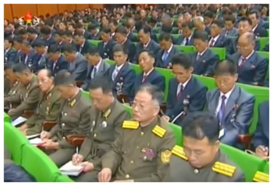 People's Security officers and provincial prospecting bureau officials take notes during the meeting (Photo: Korean Central Television).