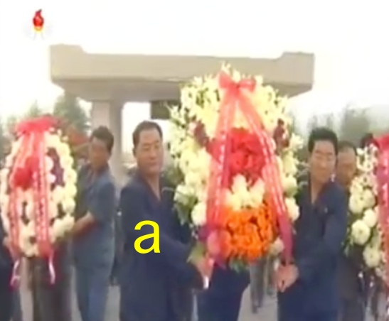South P'yo'ngan WPK Provincial Committee Chairman Pak T'ae Song [a] and provincial officials deliver floral wreaths to a cemetery in the provincial capital of P'yo'ngso'ng on September 15, 2016 (Photo: Korean Central Television).