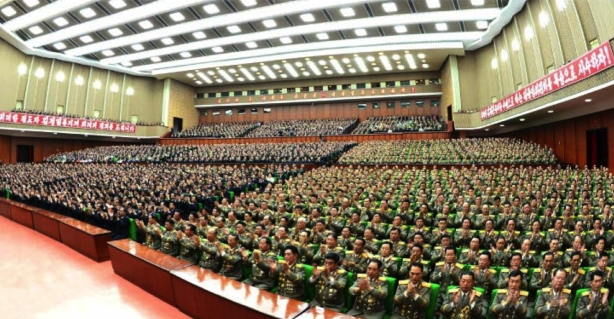 View of the venue and slogans and participants at a central report meeting in Pyongyang on October 7, 2016 to mark the 19th anniversary of Kim Jong Il's election as WPK General Secretary (Photo: Rodong Sinmun).