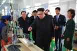 Kim Jong Un views a manufacturing area of the Mangyo'ngdae Revolutionary Site Souvenir Factory (Photo: Rodong Sinmun).