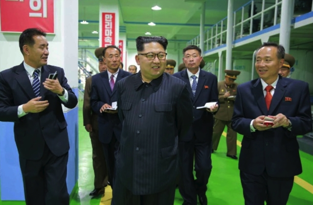 Kim Jong Un tours a manufacturing area at Ryongaksan Soap Factory in western Pyongyang in an image seen top-center on the front page of the October 29, 2016 edition of the WPK daily organ Rodong Sinmun (Photo: Rodong Sinmun).