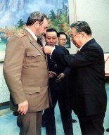 Late DPRK President and founder Kim Il Sung (Kim Il-so'ng) an award on Fidel Castro during a ceremony at the Ku'msusan Assembly Hall (now Ku'msusan Palace of the Sun) on March 8, 1986.  According to DPRK state radio's report at the time, Fidel was given the title Hero of the DPRK,  the Gold Star Medal and National Order of the Flag Hero 1st Class, and other members of his delegation were given state awards and titles (Photo: NK Leadership Watch file photo).