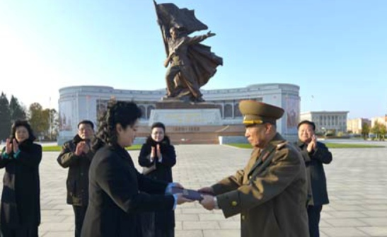 Korean Democratic Women's Union Central Committee Chair Kim Jong Sun hands over a presentation certificate to a Ministry of People's Armed Forces official during a November 8, 2016 ceremony (Photo: KCNA).