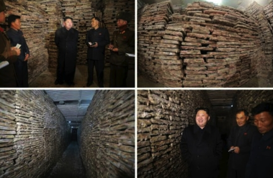 Kim Jong Un tours the storage area of the August 25 Fishery Sation in photos which appeared on page 2 of the November 20, 2016 edition of the WPK daily organ Rodong Sinmun (Photos: Rodong Sinmun/KCNA).
