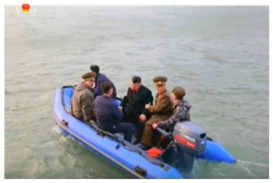 Kim Jong Un and senior members of the KPA high command Col. Gen. Ri Yo'ng-kil and Lt. Gen. Ri So'ng-kuk embark on a raft from his personal boat to Kali Islet (Photo: Korean Central Television).