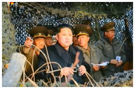 Kim Jong Un is briefed about Kali Islet's planning and operations whilst looking at Yo'npy'o'ng Island, ROK (Photo: Korean Central Television).