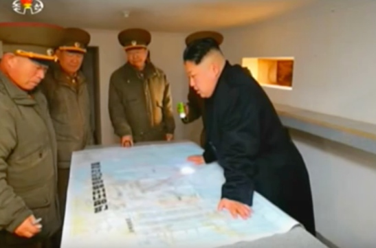 Kim Jong Un reviews a map of military deployments in the West Sea. Also in attendance (L-R) are KPA Artillery Bureau Director Maj. Gen. Pak Cho'ng-cho'n, KPA General Political Department Director VMar Hwang Pyo'ng-so and KPA General Staff Operations Bureau Director Colonel-General Ri Yo'ng-kil (Photo: Korean Central Television).