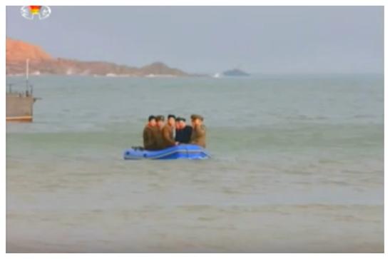 Kim Jong Un rides in a raft to Changjae Islet (Photo: Korean Central Television).