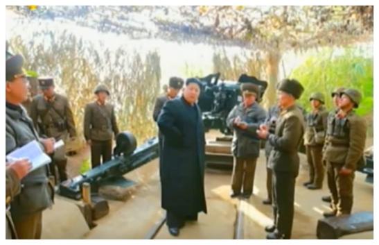Kim Jong Un issues instructions to an artillery squad at Changjae Islet coastal defense detachment (Photo: Korean Central Television).