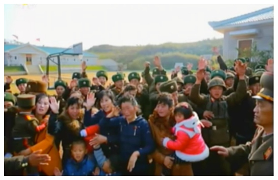 KPA service members and their families wave and shout as Kim Jong Un departs (Photo: Korean Central Television).