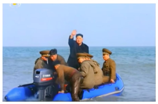 Kim Jong Un waves back to the KPA service members and their families as he departs Changjae Islet (Photo: Korean Central Television).