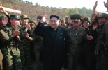 Kim Jong Un waves during a field inspection of a special forces operations battalion under KPA Unit #525 in a photo which appeared top-center of the Noveber 4, 2016 edition of the WPK daily organ Rodong Sinmun (Photo: Rodong Sinmun).