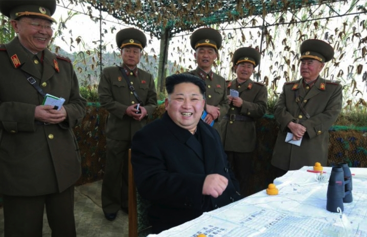 Kim Jong Un smiles during an artillery exercise during his inspection of Mahap Islet in a photo which appeared top center on the cover of the November 11, 2016 edition of the WPK daily organ Rodong Sinmun (Photo: Rodong Sinmun).