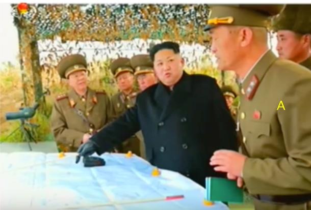 Kim Jong Un discusses artillery tactics with IV Army Corps Commander Lt.Gen. Ri So'ng-kuk (Photo: Korean Central Television).