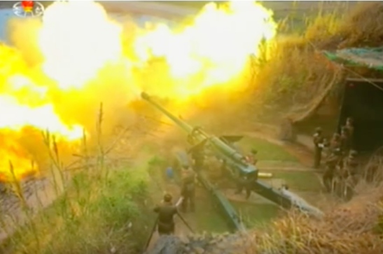 Artillery piece firing during a drill from Mahap Islet (Photo: Korean Central Television).