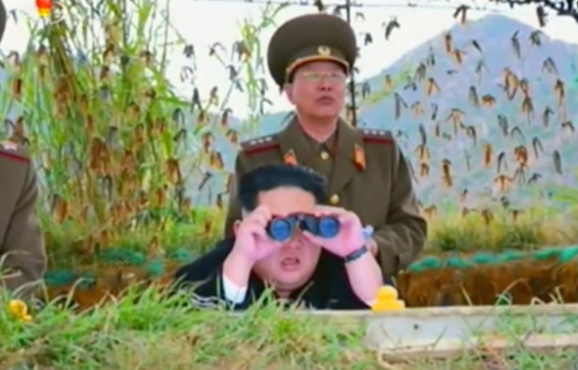 Kim Jong Un watches the artillery exercise. Also in attendance is Director of the KPA General Staff Operations Bureau Colonel-General Ri Yo'ng-kil (Photo: Korean Central Television).