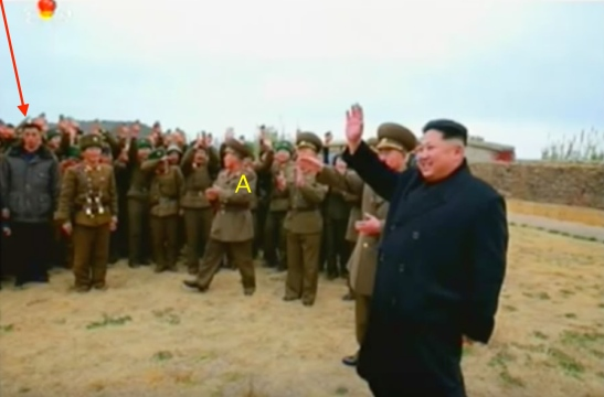 Kim Jong Un waves to KPA service members, officers and their families on Mahap Islet. Annotated is one of Jong Un's close protection escorts (bodyguards) and marked [A] is the head of the suryo'ng's security detail (Photo: Korean Central Television).