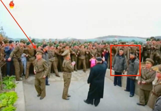 Kim Jong Un waves to KPA service members, officers and their families while departing Mahap Islet, South Hwanghae Province. Marked are the head and members of his bodyguard unit (Photo: Korean Central Television).