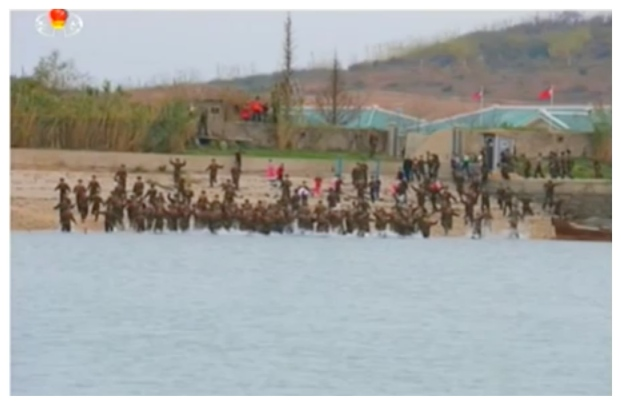 KPA service members wade into the water as Kim Jong Un departs Mahap Islet (Photo: Korean Central Television).